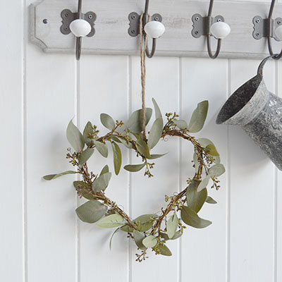 A very realistic, natural and beautiful looking Eucalyptus heart wreath with twigs for adding greenery to your home. 							  Ideal as a centre piece on a table or can be hung from a wall.