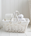 White basket with handles, ideal for storing toilet rolls or toiletries
