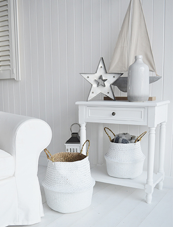 Sun bleached white furniture with naturally made home baskets give such a bright coastal look