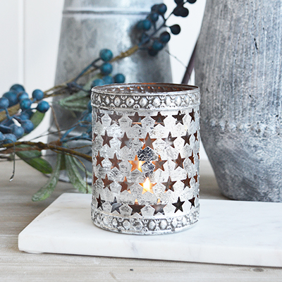 A star candle holder from The White Lighthouse furniture and accessories. New England style home decoor and accessories for coastal, country and city home interiors