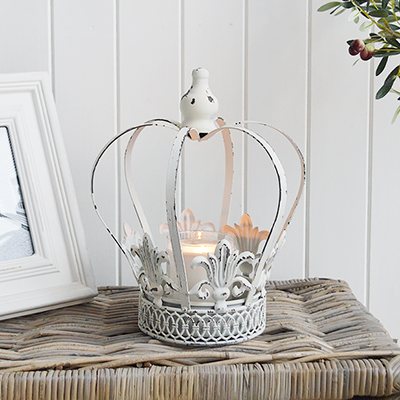 A vintage white crown candle holder