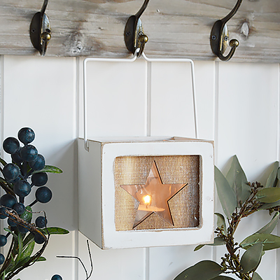 Nantucket wooden star candle holder candle hanging lantern holder with star and hanging wooden star. The range of candle holders in grey and white are a perfect accompaniment to our New England, country and coastal furniture for your bedroom, living room, hall and bathroom.