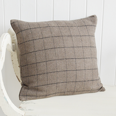 New England style interiors. A cushion in taupe and black check