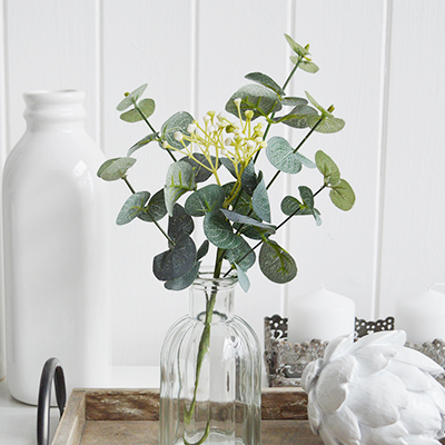 Artificial Eucalyptus sprig with white flowers. Simple greenery to add to New England styled interiors for coastal, country, city and farmhouse homes