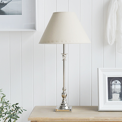 The Headington table lamp with tall silver spindle base and a linen coloured lampshade. Stunniungly luxurious styling for as style New England styled home in the living room, hallway or bedroom