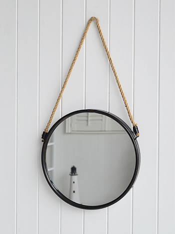A nautical themed mirror will keep to the coastal decor style as well as reflect light to ensure the room is filled with natural light