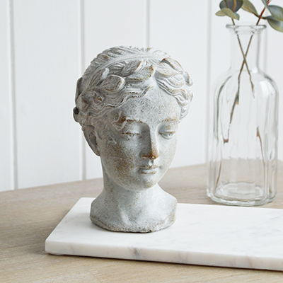 Decorative statue of a head of a woman