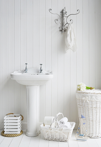 White BAthroom with hooks and baskets