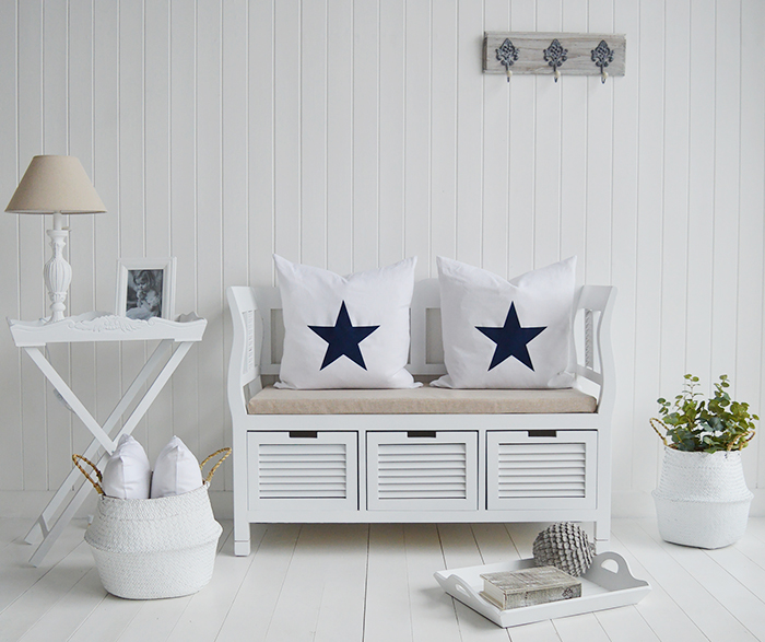 Using the traditional colours of the coast - blues, greys and shades of white in your interior design and furniture choice, you can easily create this dreamy, caming interior style of home