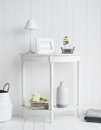 White furniture in a coastal home creates a bright and airy feeling. With beach homes generally being on the smaller side as everbody want to live here, white furniture gives the illusion of a bigger space