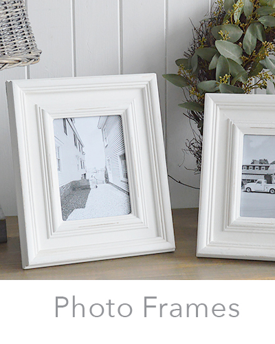 White photo frames, wall and wooden portrait and landscape 5x7, 6x4 and 10x8