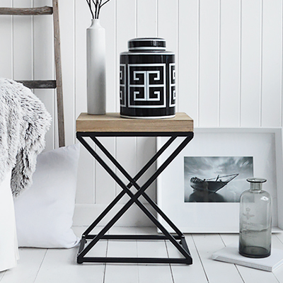 New England lamp table. A black and white palette is timeless. Mixed with natural materials, cushions and throws with plently of texture and interest gives a classic New England look to your interior.