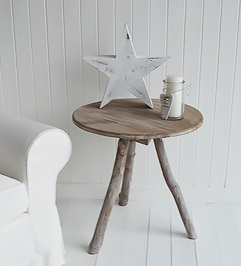 Mix weathered furniture with white and grey lamp tables add a contrasting or similarily coloured table lamp to brighten a corner.