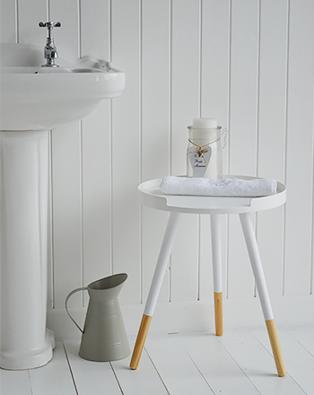 small white wooden bedside table with tripod legs